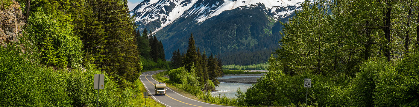 RV driving through the mountains of Alaska