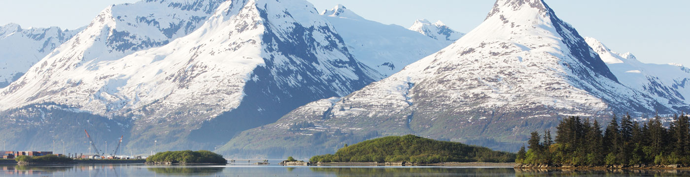 View of port in Valdez Alaska with mountain backdrop